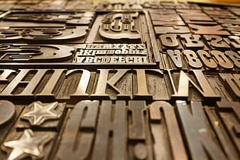 Letters embossed brown wooden panel