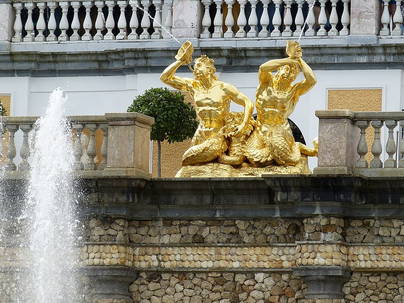 Gold statue of man and woman