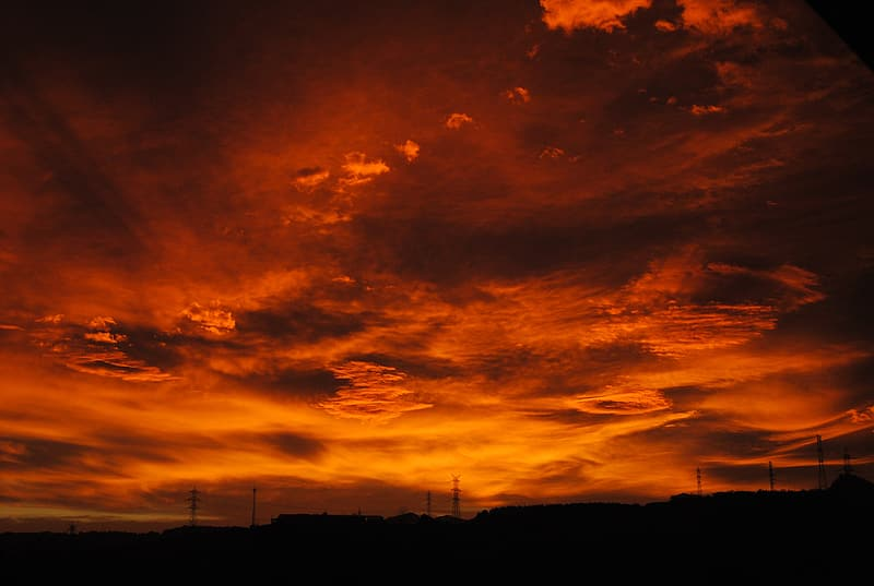 Red and orange clouds during nighttime