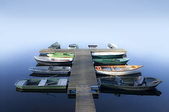 Assorted-color boats on blue body of water