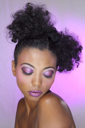 Closeup photo of woman applied with purple lipstick