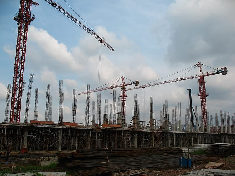 Three cranes in a construction site