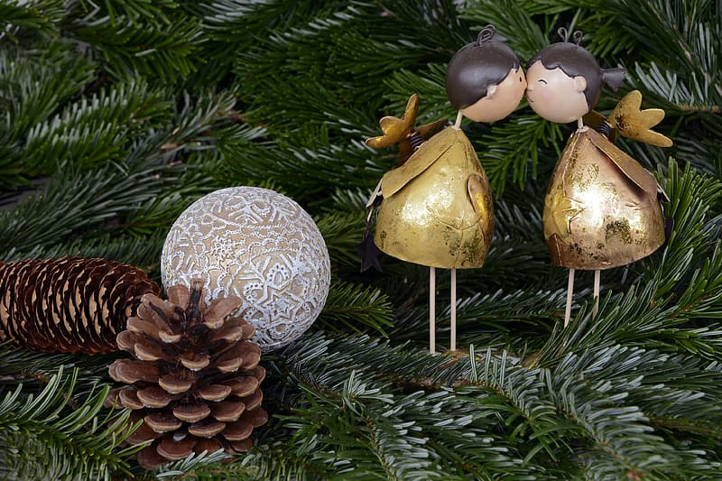 Two brown pine cones with white and brown bauble