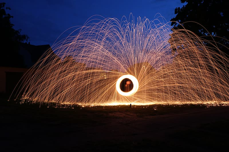 Time lapse photography of round brown fireworks