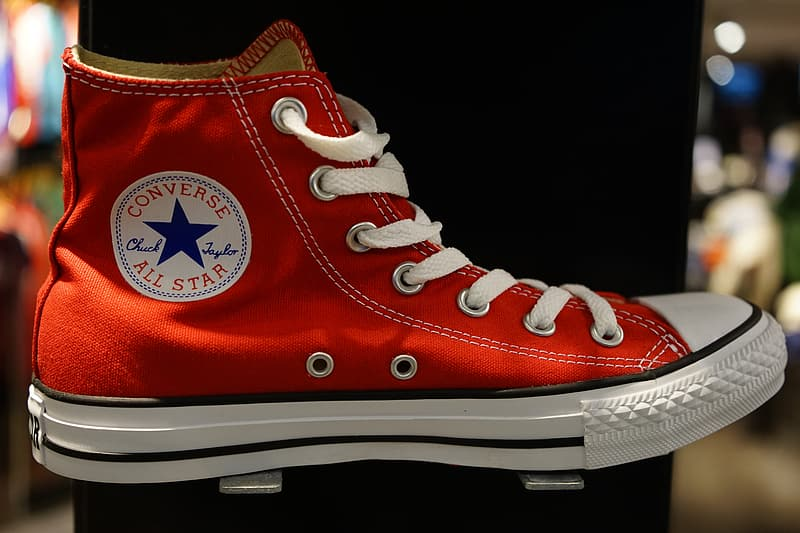 Selective focused photo of a red and white Converse All-Star high-top sneaker