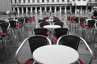 Stainless steel tables and chairs on wet floor