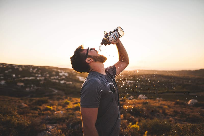 Man drinking water from sport bottle