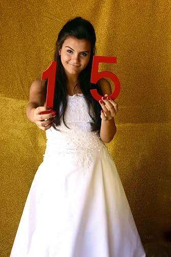 Woman holding number 15 marquee decors