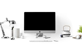 Apple desktop computer setup with white background