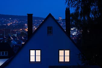 White and black house during night time