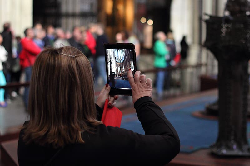 Woman holding iPad taking picture