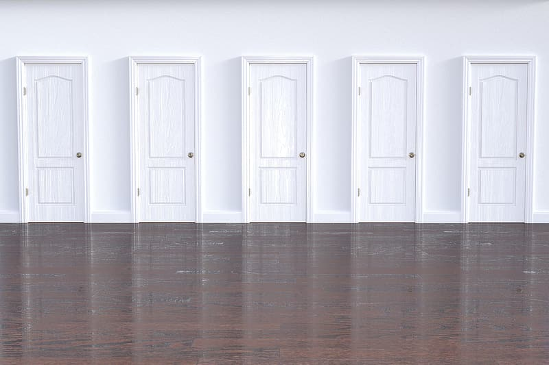 Five white wooden doors on wall