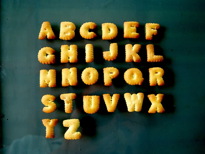 Alphabet biscuits on top of clear glass surface