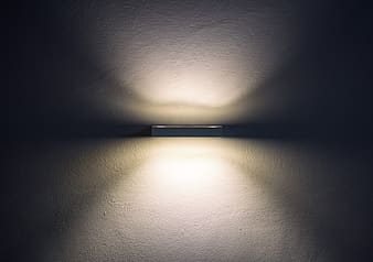White light bulb turned on in room