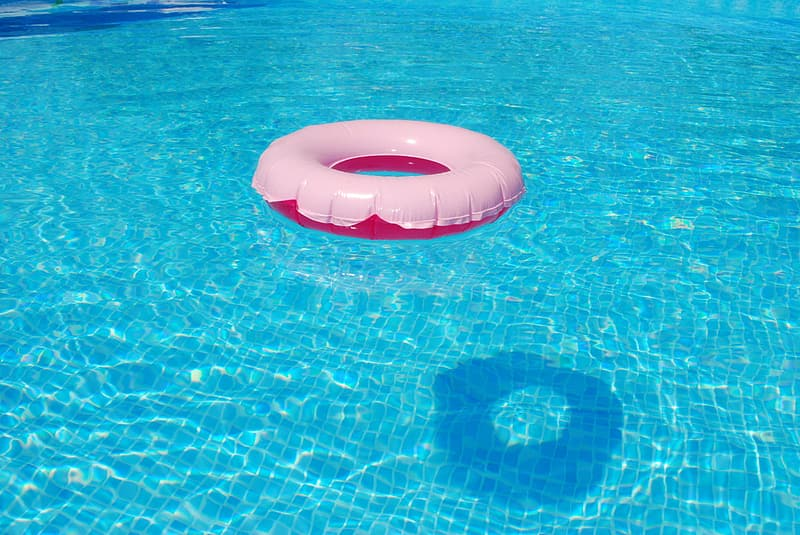 White and red buoy on blue swimming pool