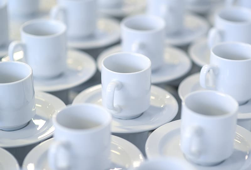 White ceramic mugs with saucers