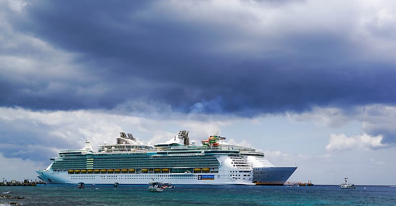 White and green cruise ship