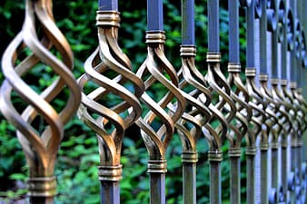 Focus photo of gray and black metal gate