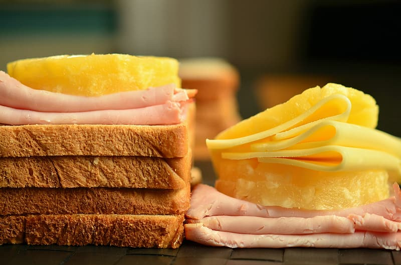 Sliced cheese and bacon with loaf bread