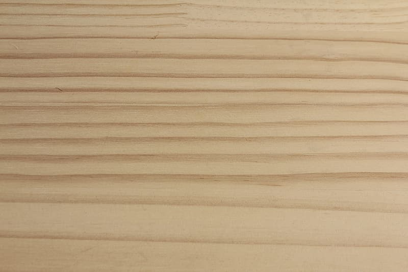 Brown wooden surface with white paper