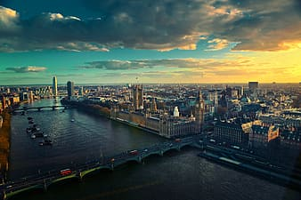 Aerial photography of Big Ben surrounded by buildings taken under white clouds during daytime