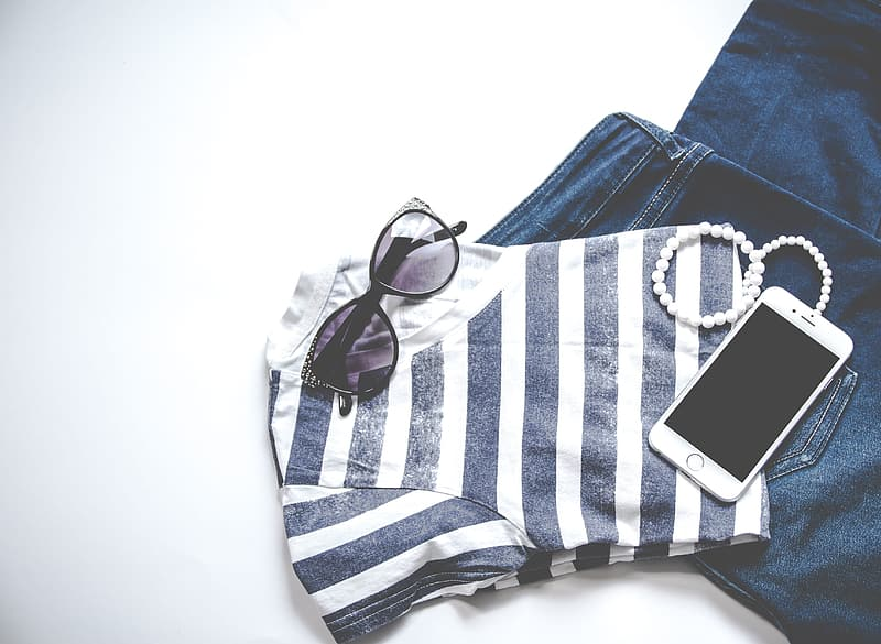 White iphone 5 on blue and white checkered textile