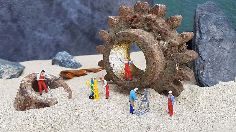 Several character figurines on sand