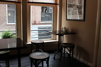 Table and chairs beside window