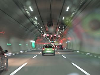 Timelapse photography of vehicle inside tunnel