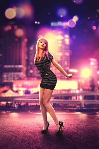 Woman in black mini dress standing on stage