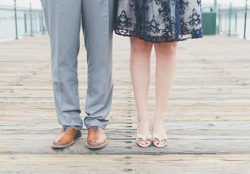 Man wears gray pants and brown leather dress shoes