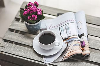 Coffee on magazine and wood crate