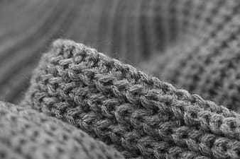 Grayscale photography of knit textile