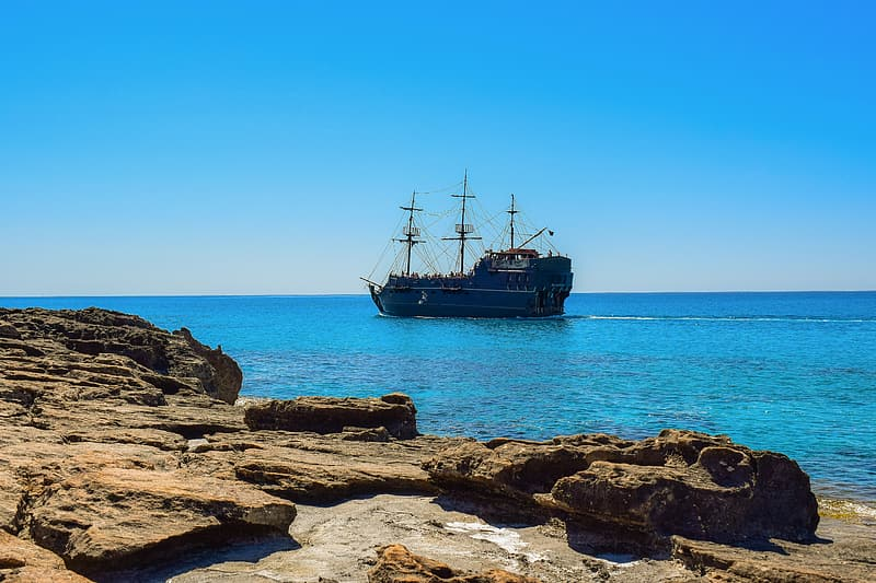 Sailing ship on body of water