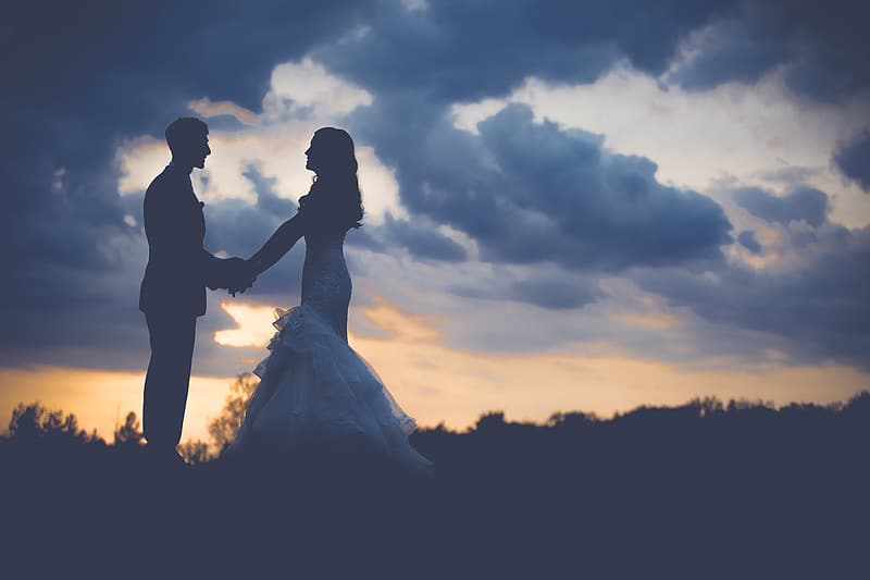Silhouette photography of couple during sunset