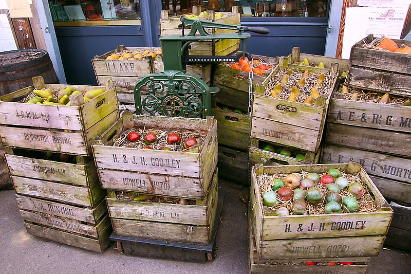 Red and green apples in brown wooden crate