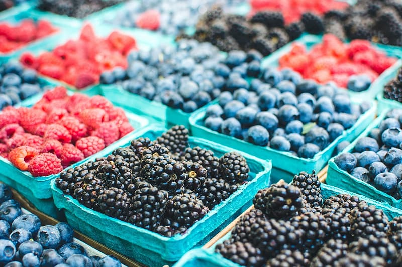 Blueberries and raspberries on container lot