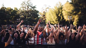 Photo of group of people raising their hands