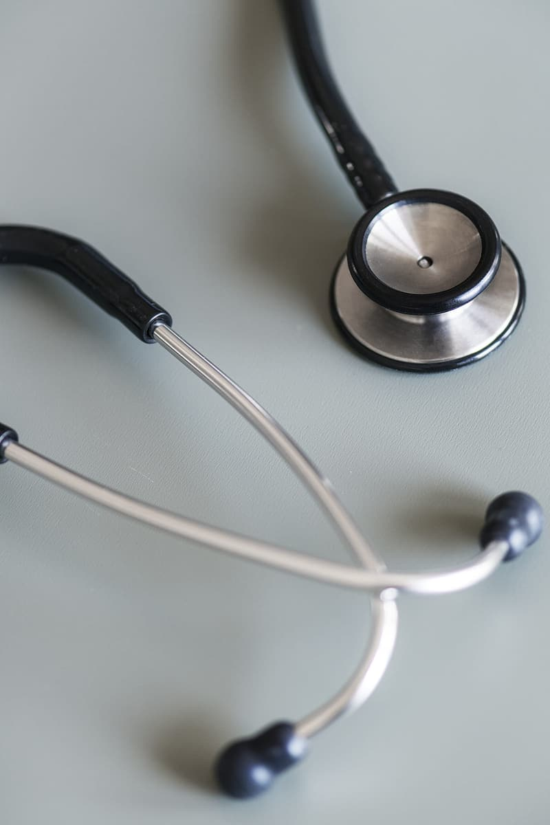 Close-up photography of gray and black stethoscope