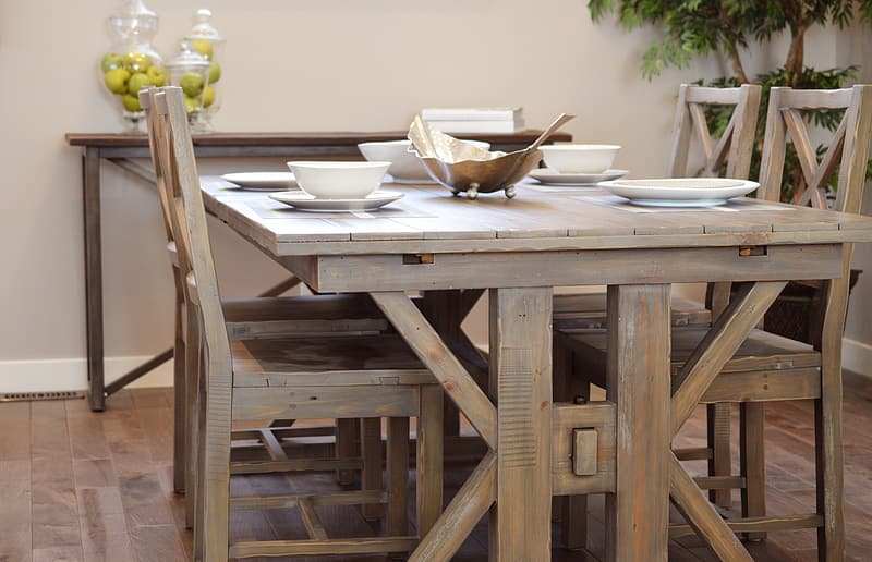 Brown wooden trestle table with four chairs dining set