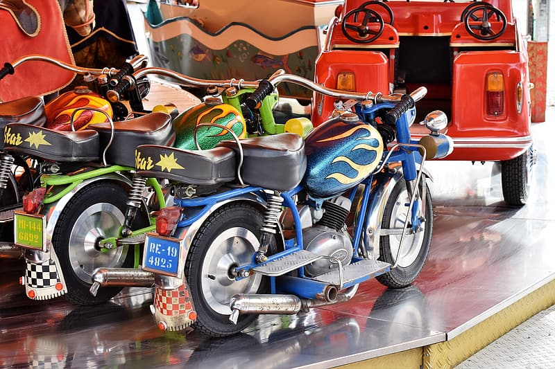Three assorted-color cruiser motorcycles scale models