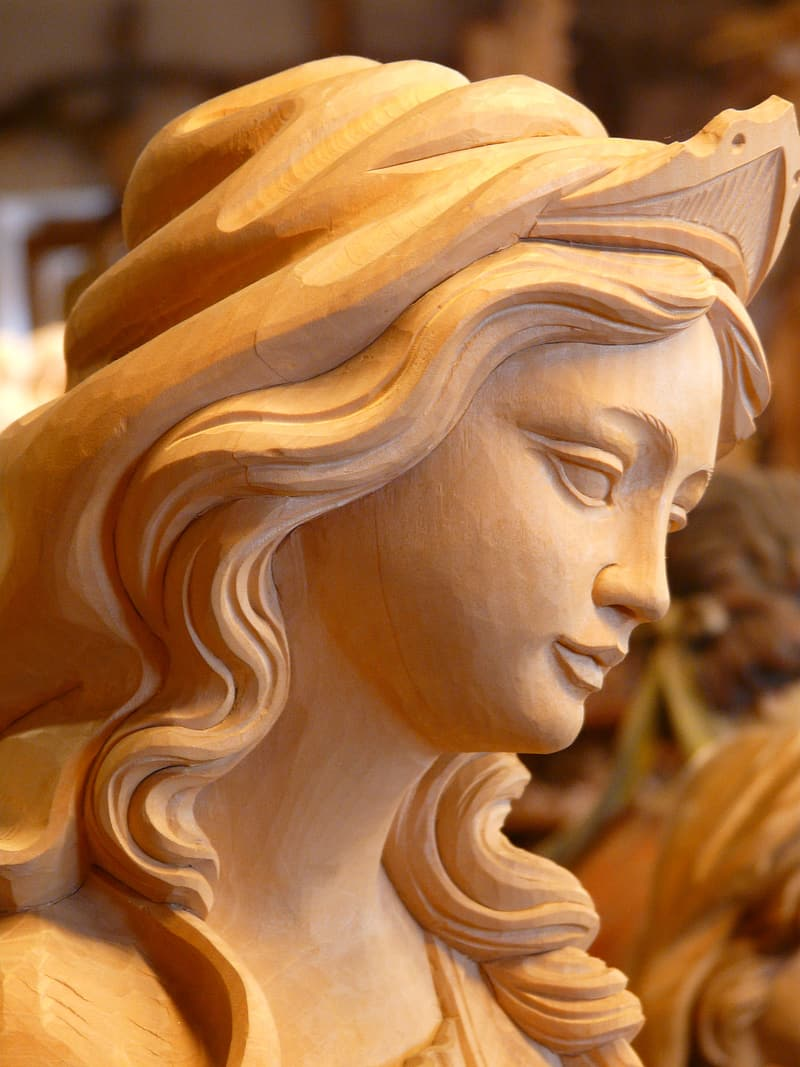 Wood carving of women