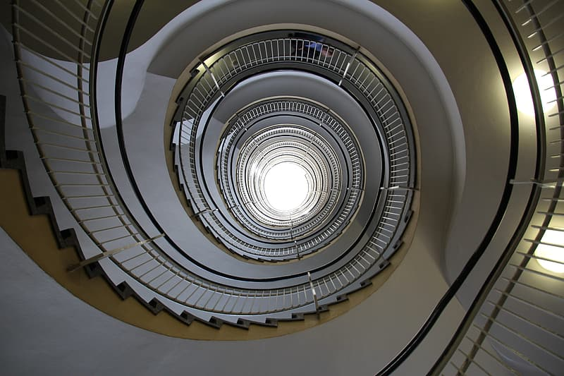 High-angle photography of spiral stairs