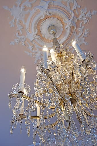 Gold-colored uplight chandelier switch on