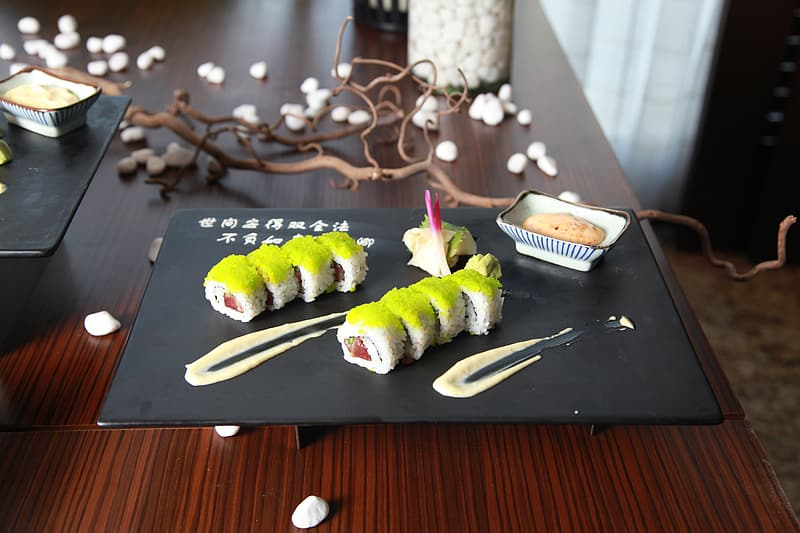 Serving of sushi on top of black plate