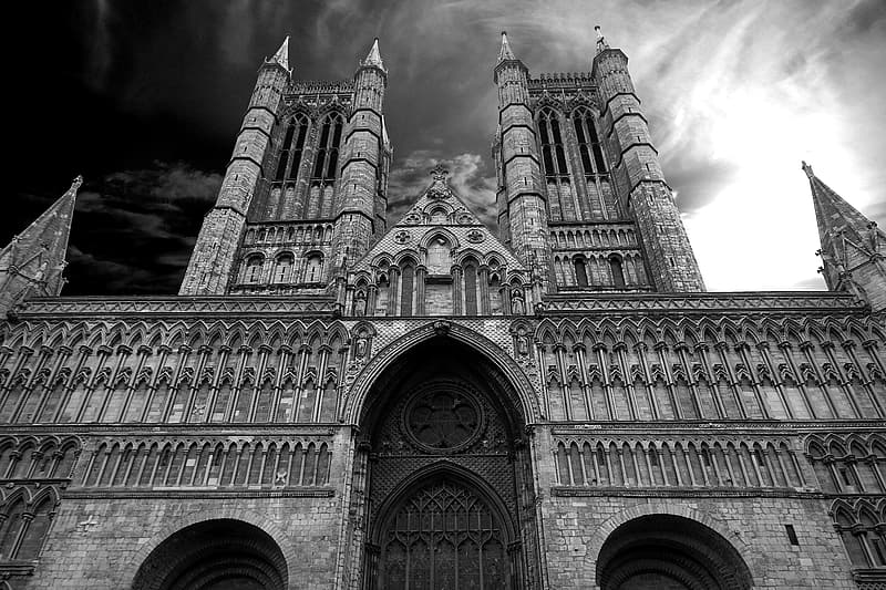 Low angle grayscale photo of cathedral