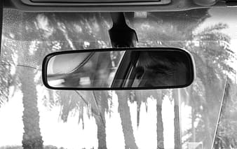Grayscale photo of car side mirror