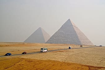 Vehicles traveling near pyramid