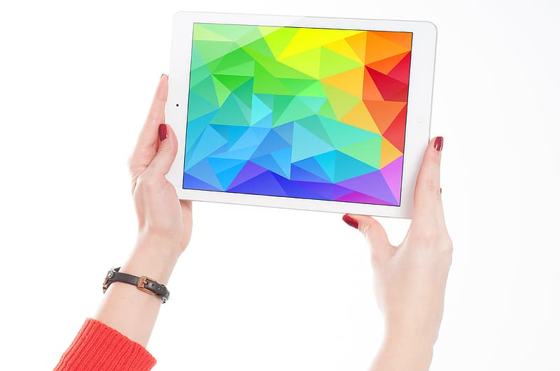 Woman holding white tablet