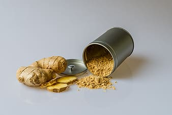 Two while gingers beside gray container with powder